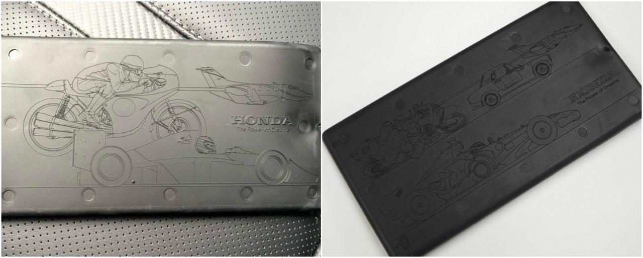 القطعة المطاطية الموجود داخل المسند الوسطي في هوندا سيفيك الجديدة تحتوي رسومات عن منتجات الشركة المتميزة